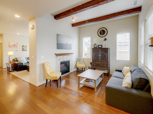 Custom wood beams in the living room add character & style.